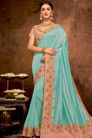 Turquoise blue Georgette and silk saree