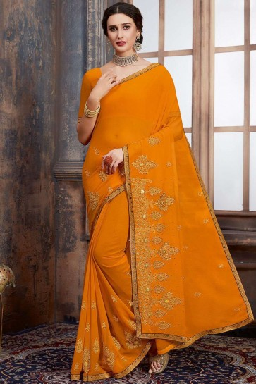 Musturd yellow Georgette saree